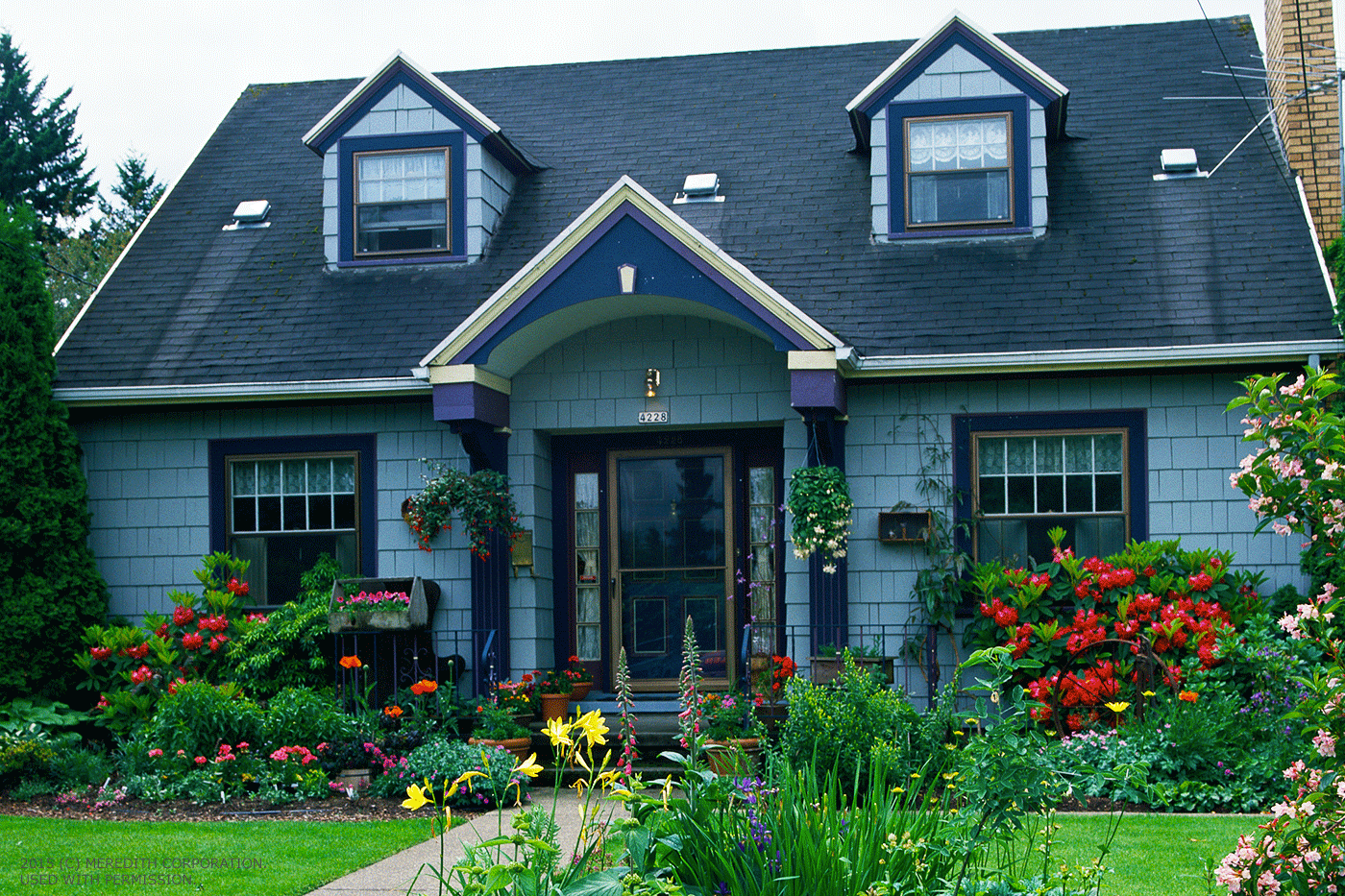 Welcoming front yard flower garden ideas better homes for Classic house with flower garden